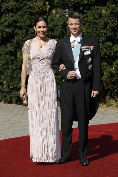 Denmark's Crown Prince Frederik (R) and Crown Princess Mary arrive for the religious wedding of his first cousin Princess Nathalie zu Sayn-Wittgestein-Berleburg and Alexander Johannsmann at the Evangelical church in Bad Berleburg June 18, 2011. REUTERS/Ina Fassbender (GERMANY - Tags: ROYALS)