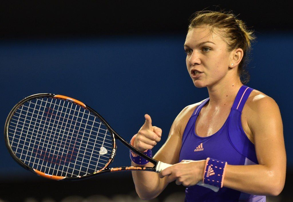 Romania's Simona Halep gestures during her women's singles match against Australia's Jarmila Gajdosova on day three of the 2015 Australian Open tennis tournament in Melbourne on January 21, 2015. AFP PHOTO / PAUL CROCK -- IMAGE RESTRICTED TO EDITORIAL USE - STRICTLY NO COMMERCIAL USE