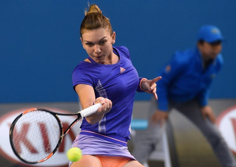 Romania's Simona Halep hits a return against Belgium's Yanina Wickmayer during their women's singles match on day seven of the 2015 Australian Open tennis tournament in Melbourne on January 25, 2015. AFP PHOTO / MAL FAIRCLOUGH -- IMAGE RESTRICTED TO EDITORIAL USE - STRICTLY NO COMMERCIAL USE